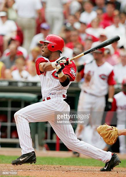 Bary Larkin of the Cincinnati Reds hits a RBI single in the seventh inning against the Texas Rangers June 17 2004 at the Great American Ball Park in...