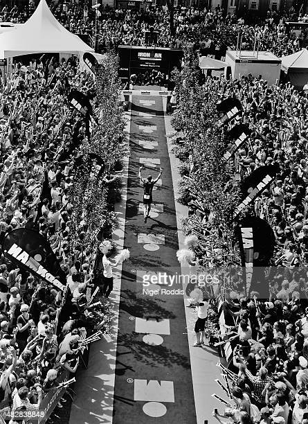 Image has been converted to black and white Bas Diederen of the Netherlands celebrates winning Ironman Limburg on August 2 2015 in Maastricht...