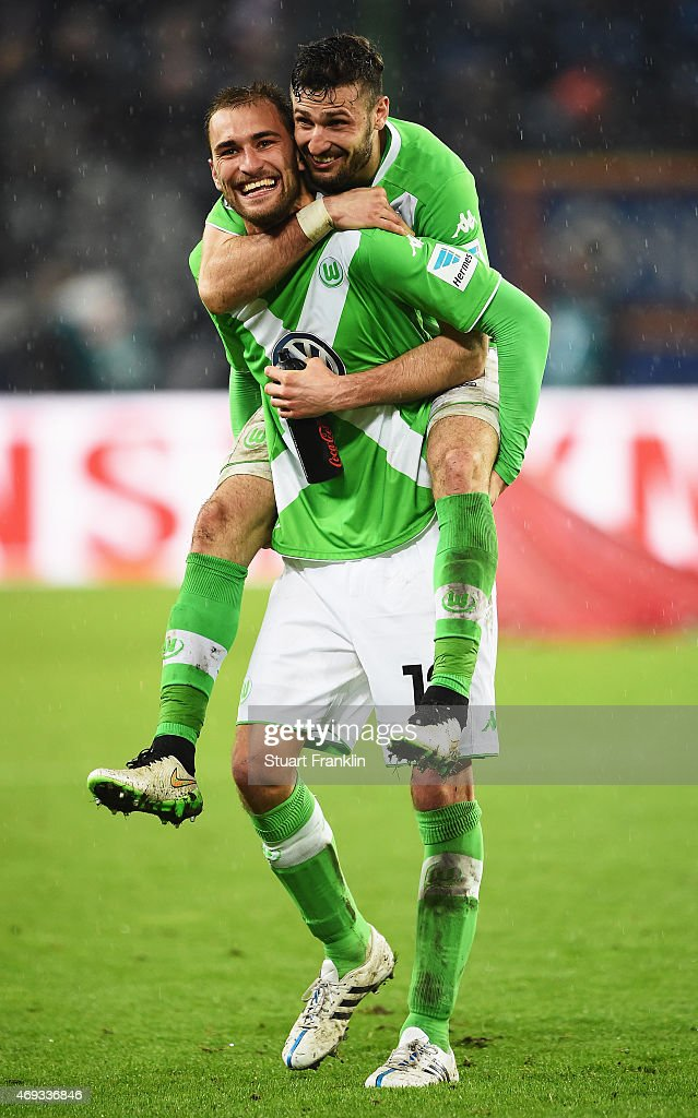 HAMBURG, GERMANY - APRIL <a gi-track='captionPersonalityLinkClicked' href=/galleries/search?phrase=Bas+Dost&family=editorial&specificpeople=7467816 ng-click='$event.stopPropagation()'>Bas Dost</a> and <a gi-track='captionPersonalityLinkClicked' href=/galleries/search?phrase=Daniel+Caligiuri&family=editorial&specificpeople=6495349 ng-click='$event.stopPropagation()'>Daniel Caligiuri</a> of Wolfsburg celebrate after the Bundesliga match between Hamburger SV and VfL Wolfsburg at Imtech Arena on April 11, 2015 in Hamburg, Germany.