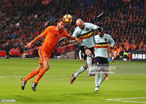 Bas Dost of the Netherlands and Laurent Ciman of Belgium jump for the ball during the international friendly match between Netherlands and Belgium at...