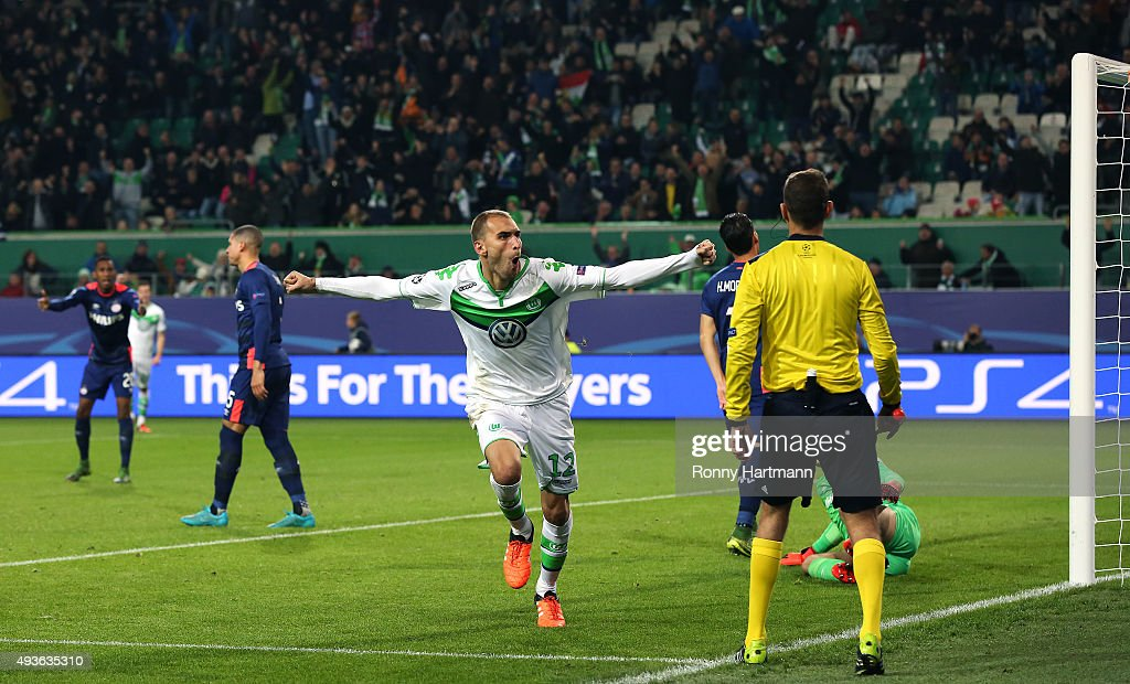 Bas Dost (C) of VfL Wolfsburg celebrates after scoring his team's opening goal during the UEFA Champions League Group B match against PSV Eindhoven at Volkswagen Arena on October 21, 2015 in Wolfsburg, Germany.