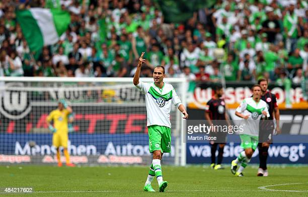 Bas Dost of VfL Wolfsburg celebrates after scoring his teams second goal during the Bundesliga match between VfL Wolfsburg and Eintracht Frankfurt at...