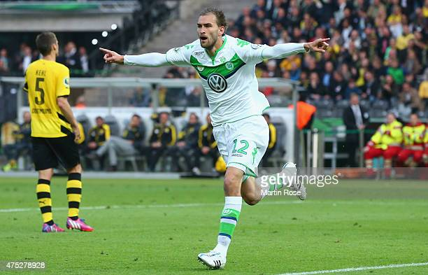 Bas Dost of VfL Wolfsburg celebrates after scoring his teams third goal during the DFB Cup Final match between Borussia Dortmund and VfL Wolfsburg at...