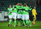 Bas Dost of VfL Wolfsburg celebrates with team mates as he scores their first goal during the UEFA Europa League Round of 32 first leg match between...