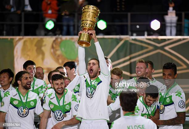 Bas Dost of VfL Wolfsburg celebrates with the trophy after his teams victory in during the DFB Cup Final match between Borussia Dortmund and VfL...