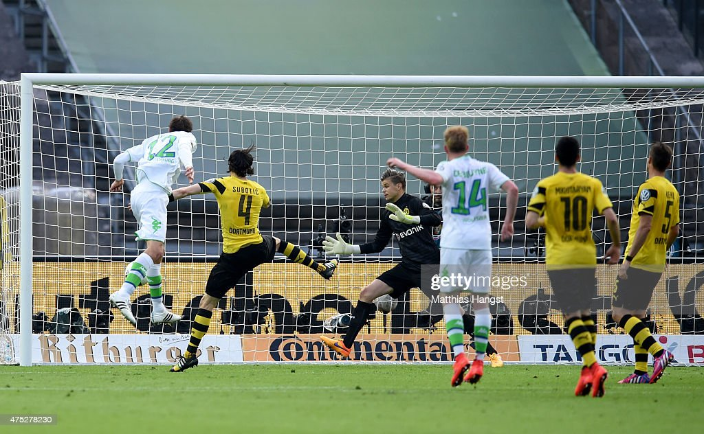 Bas Dost of VfL Wolfsburg scores his team's third goal during the DFB Cup Final match between Borussia Dortmund and VfL Wolfsburg at Olympiastadion on May 30, 2015 in Berlin, Germany.