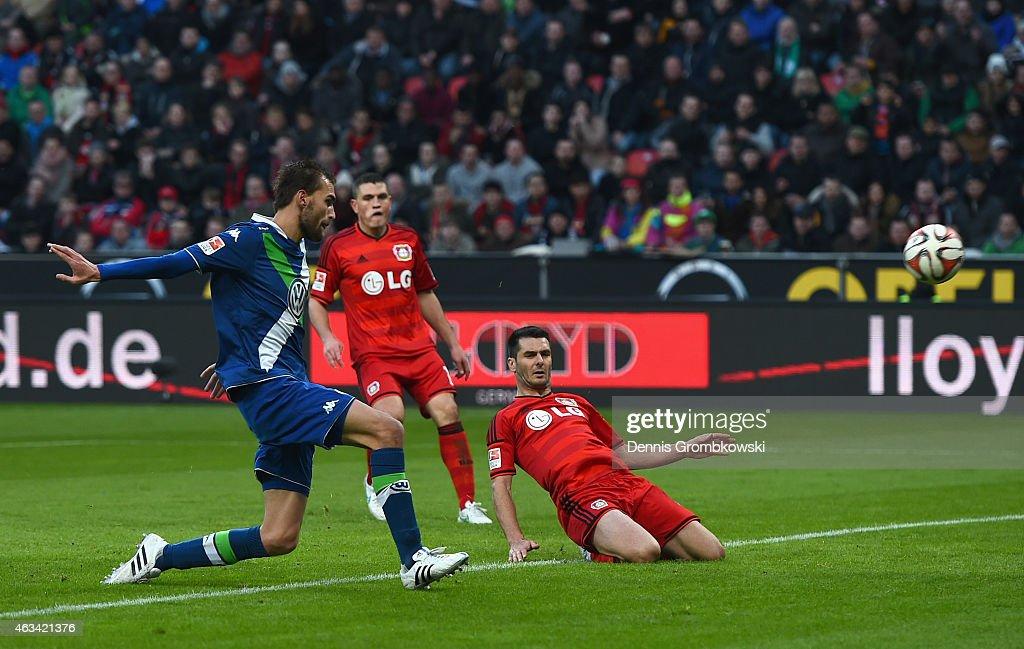 Bas Dost of VfL Wolfsburg scores the fourth goal during the Bundesliga match between Bayer 04 Leverkusen and VfL Wolfsburg at BayArena on February 14...
