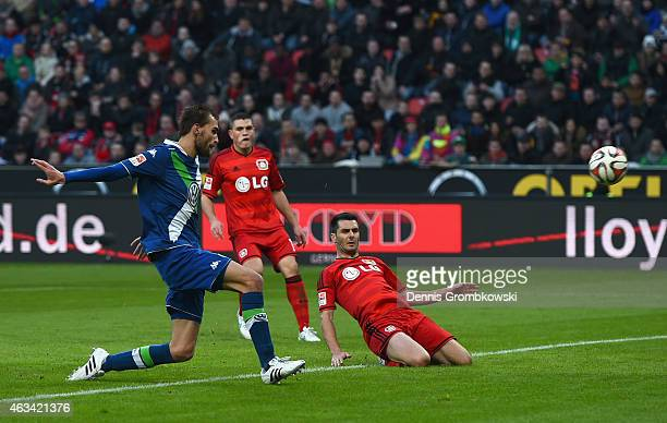 Bas Dost of VfL Wolfsburg scores the fourth goal during the Bundesliga match between Bayer 04 Leverkusen and VfL Wolfsburg at BayArena on February 14...