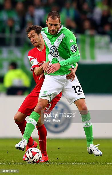 Bas Dost of Wolfsburg and Maximilian Philipp of Freiburg battle for the ball during DFB Cup Quarter Final match between VfL Wolfsburg and SC Freiburg...