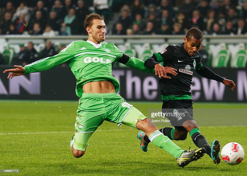 <a gi-track='captionPersonalityLinkClicked' href=/galleries/search?phrase=Bas+Dost&family=editorial&specificpeople=7467816 ng-click='$event.stopPropagation()'>Bas Dost</a> (L) of Wolfsburg and <a gi-track='captionPersonalityLinkClicked' href=/galleries/search?phrase=Theodor+Gebre+Selassie&family=editorial&specificpeople=8202004 ng-click='$event.stopPropagation()'>Theodor Gebre Selassie</a> of Bremen compete for the ball during the Bundesliga match between VfL Wolfsburg and SV Werder Bremen at Volkswagen Arena on November 24, 2012 in Wolfsburg, Germany.
