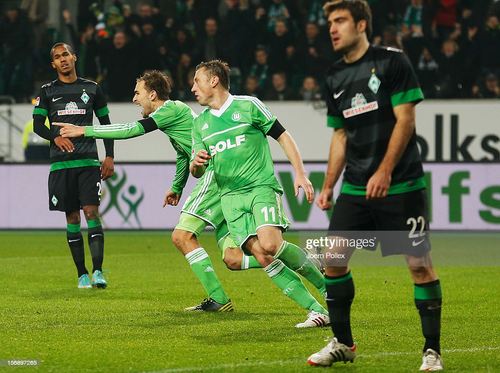 <a gi-track='captionPersonalityLinkClicked' href=/galleries/search?phrase=Bas+Dost&family=editorial&specificpeople=7467816 ng-click='$event.stopPropagation()'>Bas Dost</a> (2nd L) of Wolfsburg celebrates after scoring his team's first goal during the Bundesliga match between VfL Wolfsburg and SV Werder Bremen at Volkswagen Arena on November 24, 2012 in Wolfsburg, Germany.