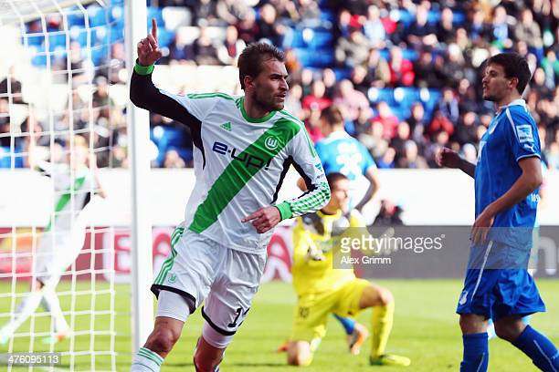 Bas Dost of Wolfsburg celebrates his team's first goal during the Bundesliga match between 1899 Hoffenheim and VfL Wolfsburg at Wirsol...