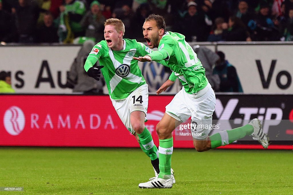 Bas Dost of Wolfsburg celebrates his team's second goal with team mate Kevin de Bruyne during the Bundesliga match between VfL Wolfsburg and FC Bayern Muenchen at Volkswagen Arena on January 30, 2015 in Wolfsburg, Germany.