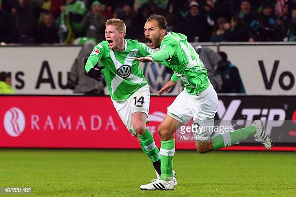 Bas Dost of Wolfsburg celebrates his team's second goal with team mate Kevin de Bruyne during the Bundesliga match between VfL Wolfsburg and FC...