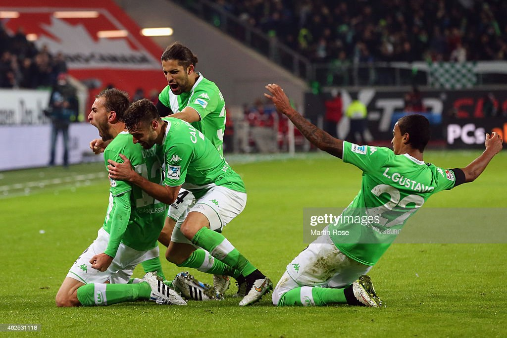 <a gi-track='captionPersonalityLinkClicked' href=/galleries/search?phrase=Bas+Dost&family=editorial&specificpeople=7467816 ng-click='$event.stopPropagation()'>Bas Dost</a> of Wolfsburg celebrates his team's second goal with team mates <a gi-track='captionPersonalityLinkClicked' href=/galleries/search?phrase=Daniel+Caligiuri&family=editorial&specificpeople=6495349 ng-click='$event.stopPropagation()'>Daniel Caligiuri</a>, <a gi-track='captionPersonalityLinkClicked' href=/galleries/search?phrase=Ricardo+Rodriguez+-+Soccer+Player&family=editorial&specificpeople=8768006 ng-click='$event.stopPropagation()'>Ricardo Rodriguez</a> and Luiz Gustavo (L-R) during the Bundesliga match between VfL Wolfsburg and FC Bayern Muenchen at Volkswagen Arena on January 30, 2015 in Wolfsburg, Germany.