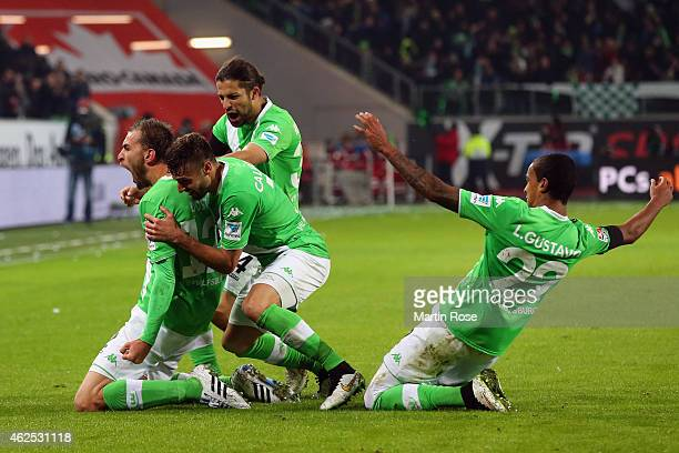 Bas Dost of Wolfsburg celebrates his team's second goal with team mates Daniel Caligiuri Ricardo Rodriguez and Luiz Gustavo during the Bundesliga...