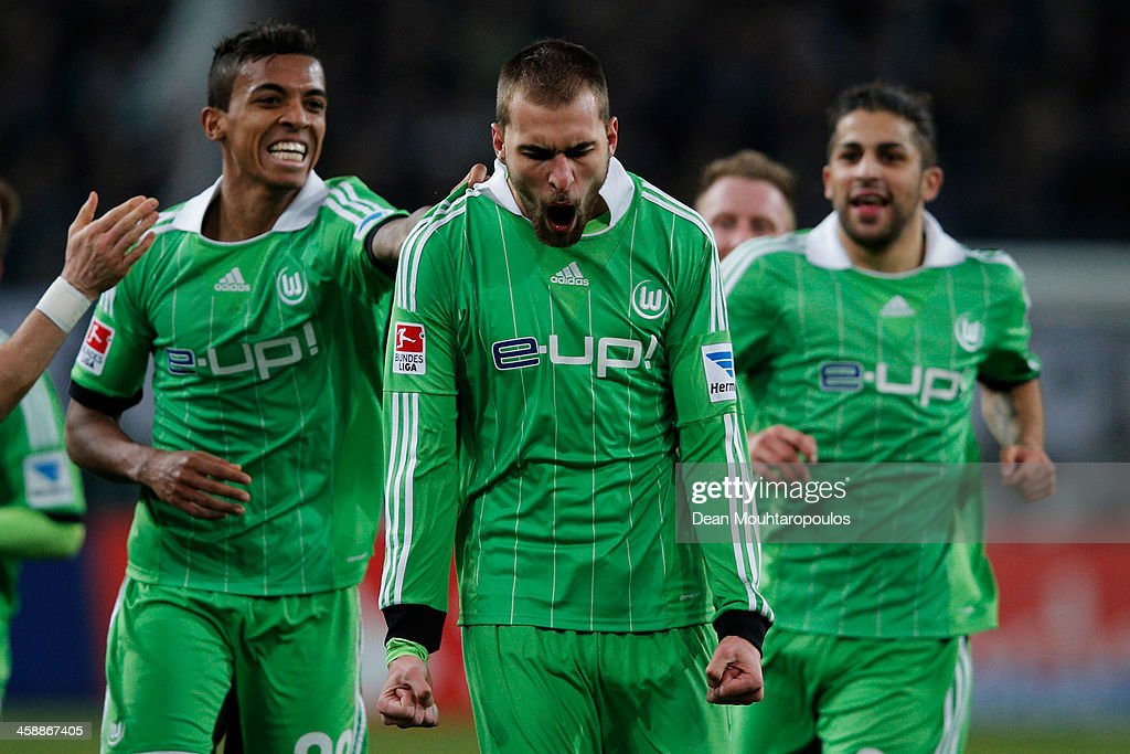 <a gi-track='captionPersonalityLinkClicked' href=/galleries/search?phrase=Bas+Dost&family=editorial&specificpeople=7467816 ng-click='$event.stopPropagation()'>Bas Dost</a> (#12) of Wolfsburg celebrates scoring his teams second goal of the game during the Bundesliga match between Borussia Moenchengladbach and VfL Wolfsburg held at Borussia-Park on December 22, 2013 in Moenchengladbach, Germany.