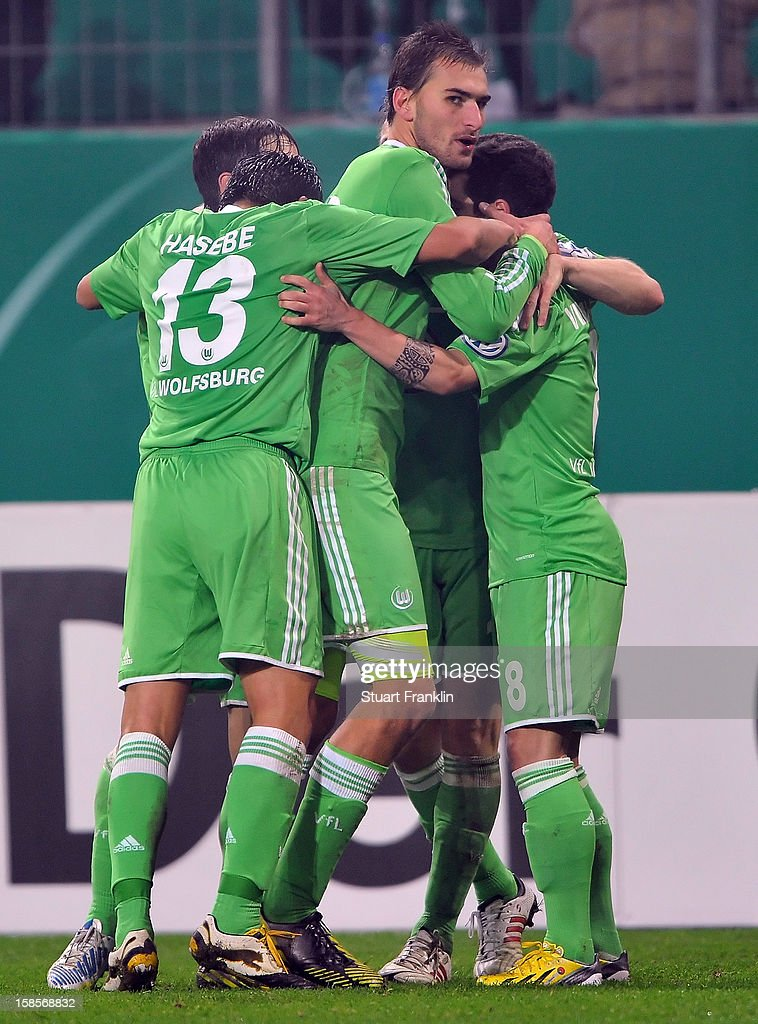 <a gi-track='captionPersonalityLinkClicked' href=/galleries/search?phrase=Bas+Dost&family=editorial&specificpeople=7467816 ng-click='$event.stopPropagation()'>Bas Dost</a> of Wolfsburg celebrates scoring the winning goal with teamates during the round of 16 of the DFB cup match between VfL Wolfsburg and Bayer Leverkusen at Volkswagen Arena on December 19, 2012 in Wolfsburg, Germany.