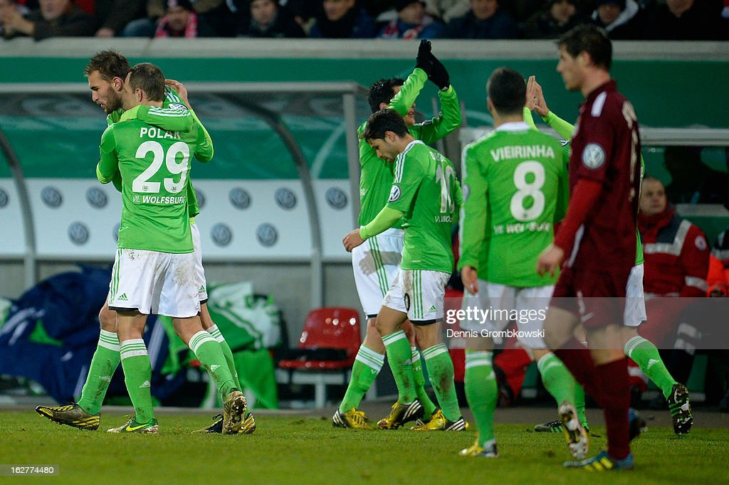<a gi-track='captionPersonalityLinkClicked' href=/galleries/search?phrase=Bas+Dost&family=editorial&specificpeople=7467816 ng-click='$event.stopPropagation()'>Bas Dost</a> of Wolfsburg celebrates with teammates after scoring his team's second goal during the DFB Cup match between Kickers Offenbach and VfL Wolfsburg on February 26, 2013 in Offenbach, Germany.