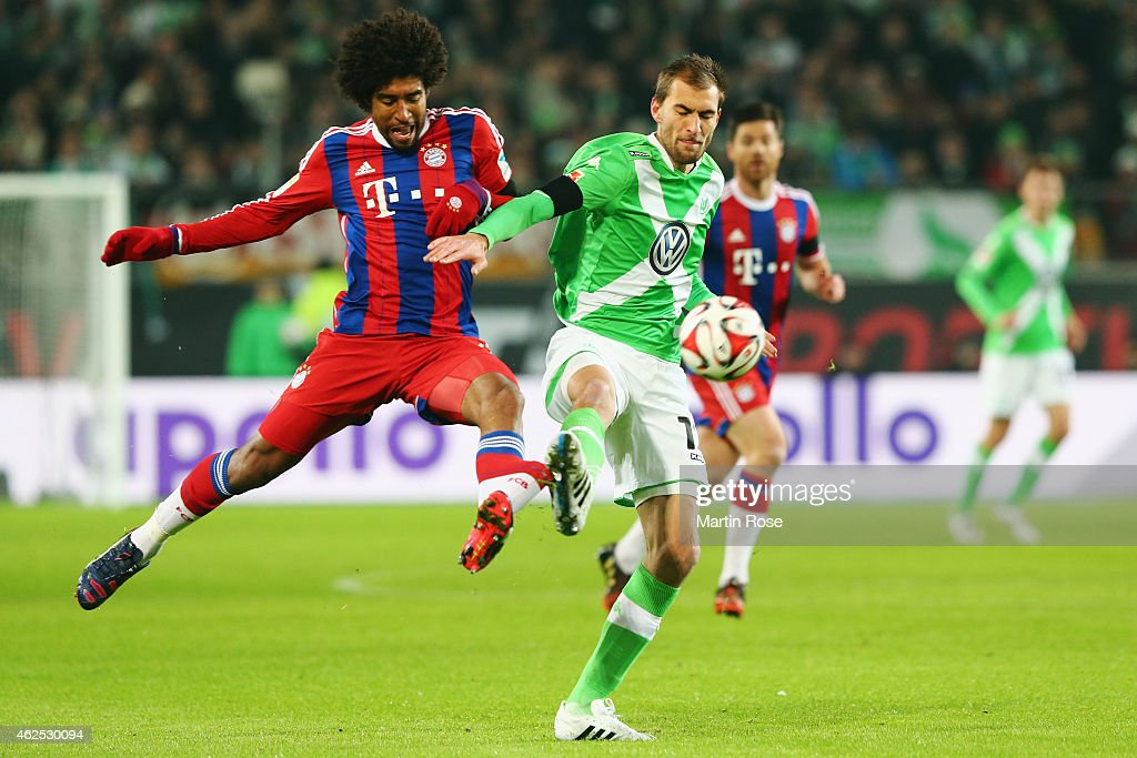 <a gi-track='captionPersonalityLinkClicked' href=/galleries/search?phrase=Bas+Dost&family=editorial&specificpeople=7467816 ng-click='$event.stopPropagation()'>Bas Dost</a> (R) of Wolfsburg is challenged by Dante of Muenchen during the Bundesliga match between VfL Wolfsburg and FC Bayern Muenchen at Volkswagen Arena on January 30, 2015 in Wolfsburg, Germany.