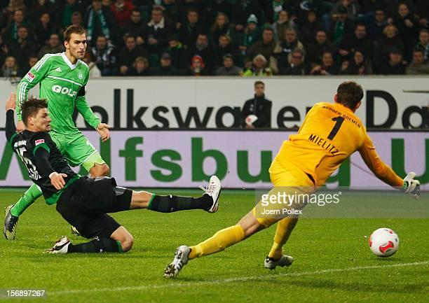 Bas Dost of Wolfsburg scores his team's first goal during the Bundesliga match between VfL Wolfsburg and SV Werder Bremen at Volkswagen Arena on...