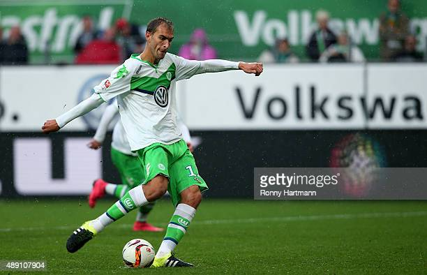 Bas Dost of Wolfsburg scores his team's second goal from the penalty spot during the Bundesliga match between VfL Wolfsburg and Hertha BSC at...