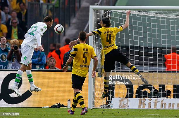 Bas Dost of Wolfsburg scores his team's third goal during the DFB Cup Final match between Borussia Dortmund and VfL Wolfsburg at Olympiastadion on...