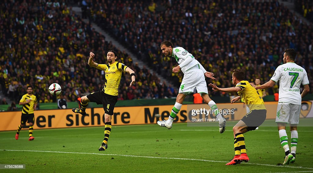 Bas Dostof Wolfsburg scores the third goal during the DFB Cup Final between Borussia Dortmund and VfL Wolfsburg at Olympiastadion on May 30, 2015 in Berlin, Germany.