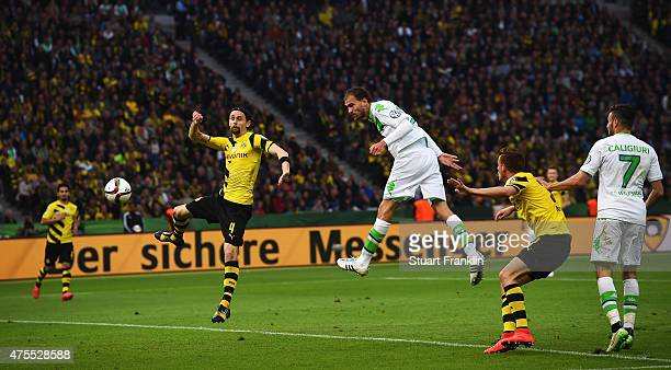 Bas Dostof Wolfsburg scores the third goal during the DFB Cup Final between Borussia Dortmund and VfL Wolfsburg at Olympiastadion on May 30 2015 in...