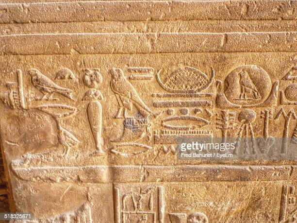 Bas Relief Figures And Hieroglyphics On The Wall Of A Temple