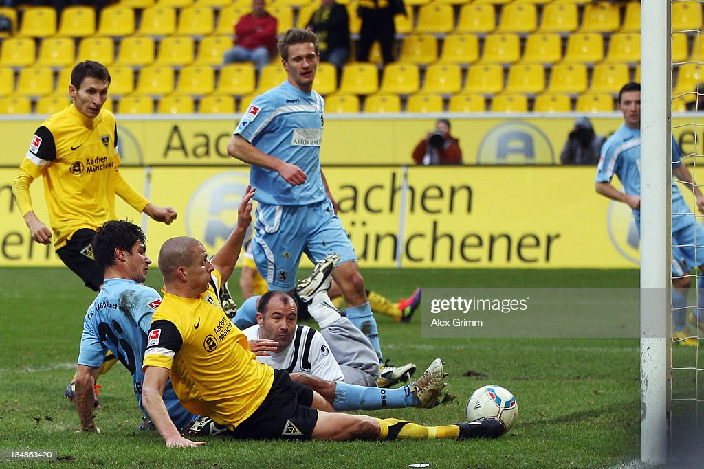 Bas Sibum of Aachen scores his team's second goal against Christopher Schindler and goalkeeper Gabor Kiraly of Muenchen during the Second Bundesliga match between Alemannia Aachen and 1860 Muenchen at Tivoli Stadium on December 4, 2011 in Aachen, Germany.