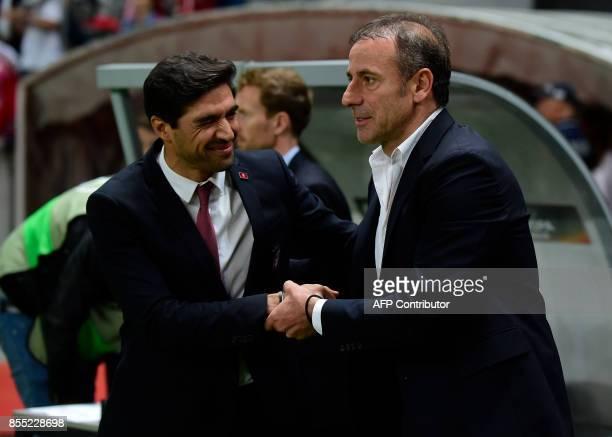 Basaksehir's coach Abdullah Avci shakes hands with Sporting Braga's coach Abel Ferreira before the UEFA Europa league football match SC Braga vs...