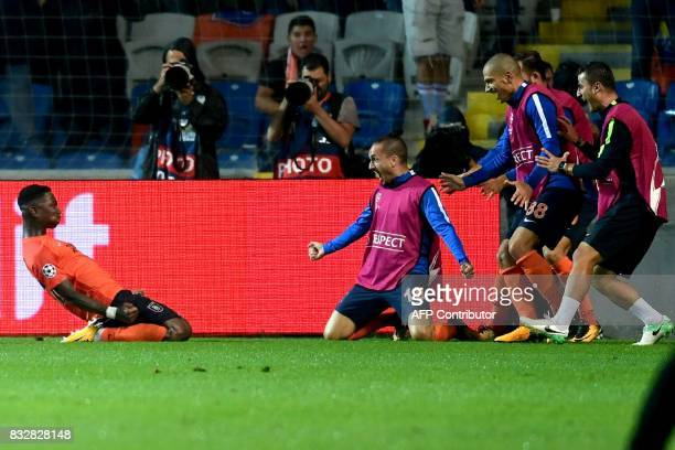 Basaksehir's Eljero Elia celebrates with his teammates after scoring a goal during the UEFA Champions League playoff first leg football match between...
