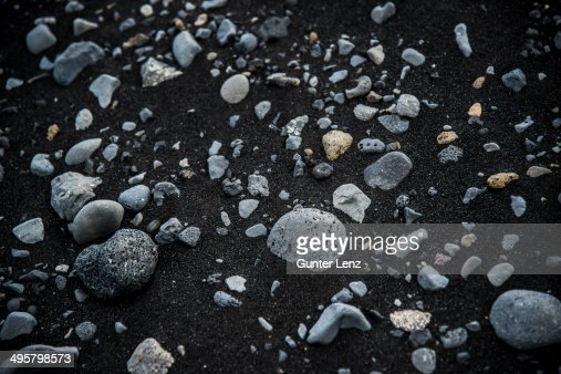 Basalt stones in black lava sand, Skeioararsandur, Southern Region, Iceland