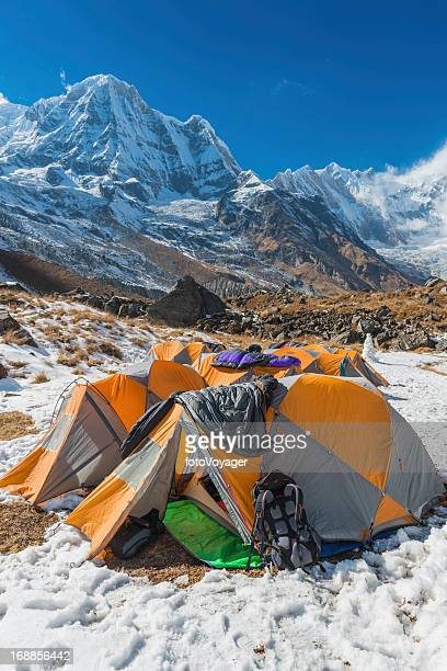 Base camp tents in snowy mountain valley
