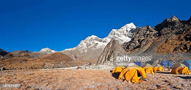 Base camp tents wilderness camping Himalaya mountain peaks panorama Nepal