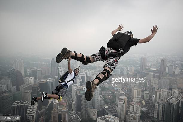 Base jumper David Laffargue and Rodolphe Roger Coianiz from France leap from the 300metres Open Deck of the Malaysia's landmark Kuala Lumpur Tower...