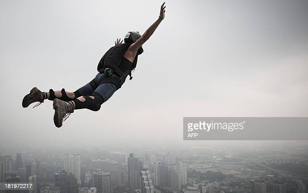 Base jumper Katherine Donahue from the US leaps from the 300metres Open Deck of the Malaysia's landmark Kuala Lumpur Tower during the International...