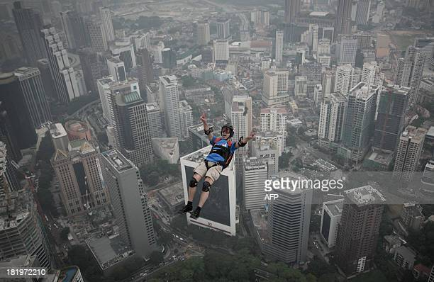Base jumper Olivier Julien Chacornac from France leaps from the 300metres Open Deck of the Malaysia's landmark Kuala Lumpur Tower during the...