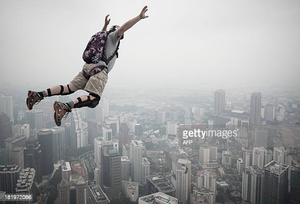 Base jumper Peter Andexlinger from the US leaps from the 300metres Open Deck of the Malaysia's landmark Kuala Lumpur Tower during the International...