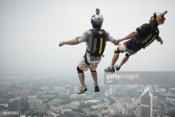 Base jumper Vincent Philippe Benjamin Reffet and Frederic Yves Fugen from France leap from the 300metres Open Deck of the Malaysia's landmark Kuala...