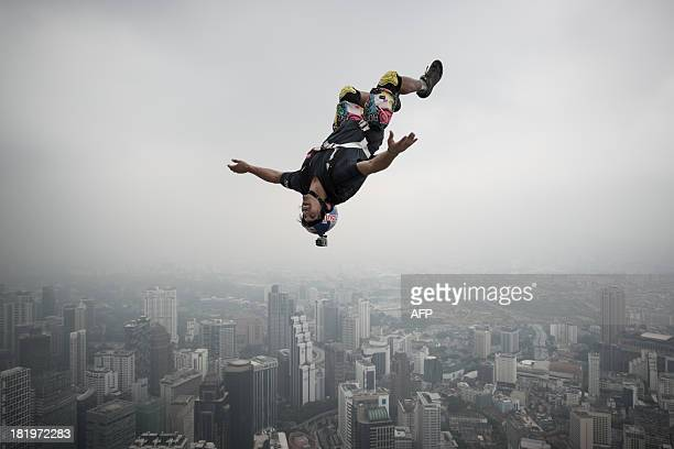 Base jumper Vincent Philippe Benjamin Reffet from France leaps from the 300metres Open Deck of the Malaysia's landmark Kuala Lumpur Tower during the...