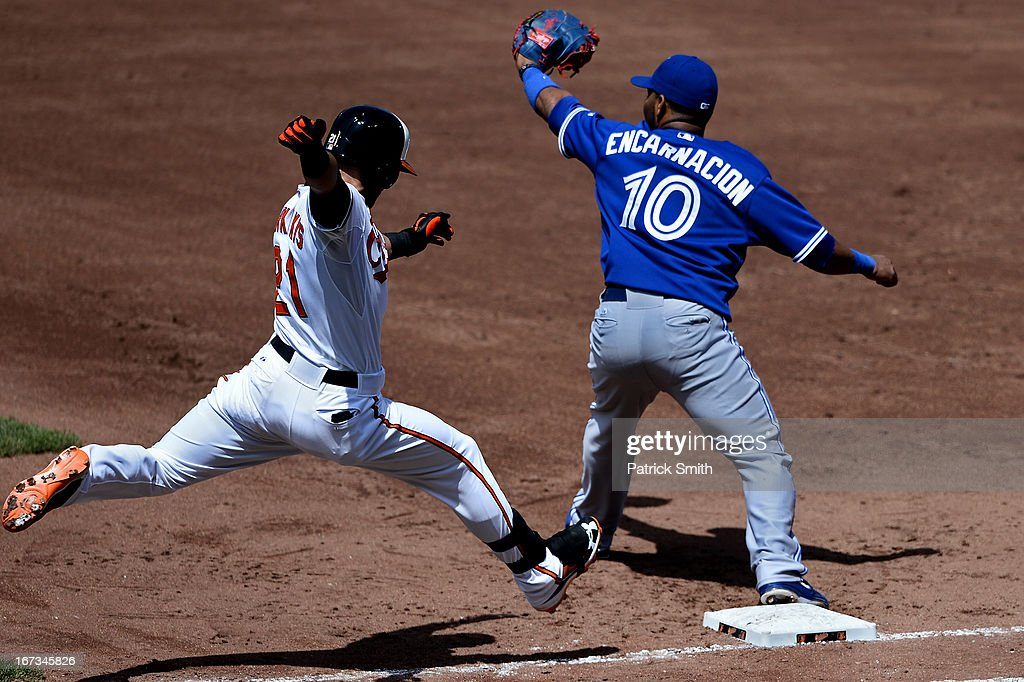 Base runner <a gi-track='captionPersonalityLinkClicked' href=/galleries/search?phrase=Nick+Markakis&family=editorial&specificpeople=614708 ng-click='$event.stopPropagation()'>Nick Markakis</a> #21 of the Baltimore Orioles is forced out at first base as first baseman Edwin Encarnacion #10 of the Toronto Blue Jays makes the out in the sixth inning at Oriole Park at Camden Yards on April 24, 2013 in Baltimore, Maryland. The Toronto Blue Jays won, 6-5.