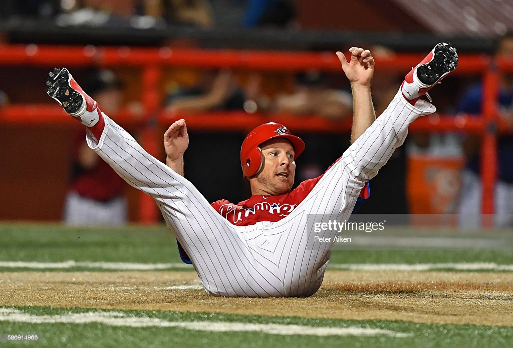 Base runner Pete Orr of the Kansas Stars rolls onto his back after scoring a run against the Colorado Xpress in the seventh inning during the NBC...