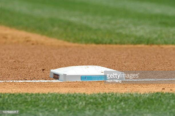 A base with the Father's Day logo on it is seen during the game between the New York Yankees and the New York Mets at Yankee Stadium in the Bronx New...