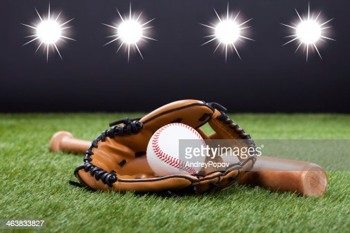 Baseball Accessories On Ground : Stock Photo