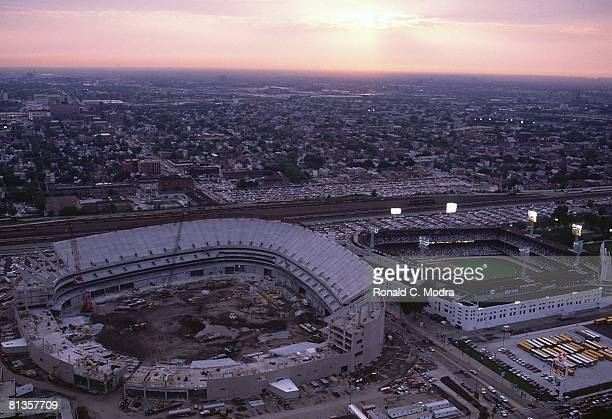 Baseball Aerial scenic view of old Comiskey Park and New Comiskey Park stadium during Chicago White Sox vs Oakland Athletics game Sunset Chicago IL...