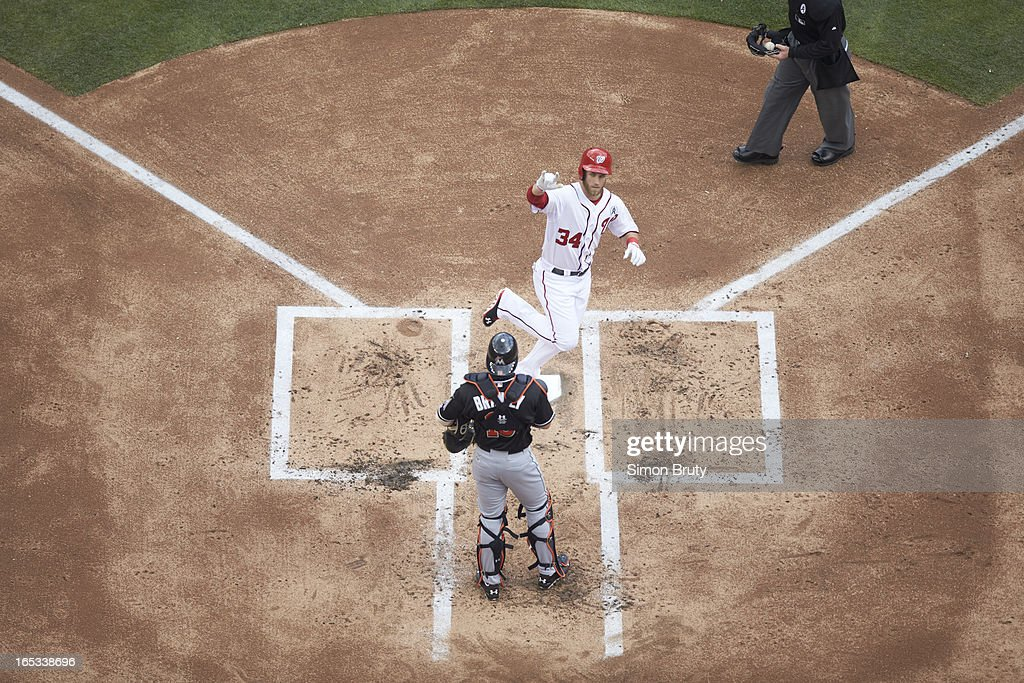 Aerial view of Washington Nationals Bryce Harper (34) victorious, crossing home plate after hitting home run vs Miami Marlins at Nationals Park. Simon Bruty F94 )