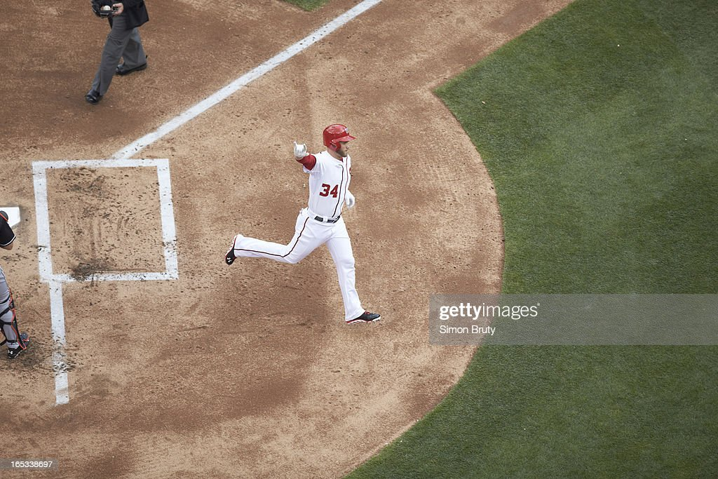 Aerial view of Washington Nationals Bryce Harper (34) victorious, crossing home plate after hitting home run vs Miami Marlins at Nationals Park. Simon Bruty F100 )