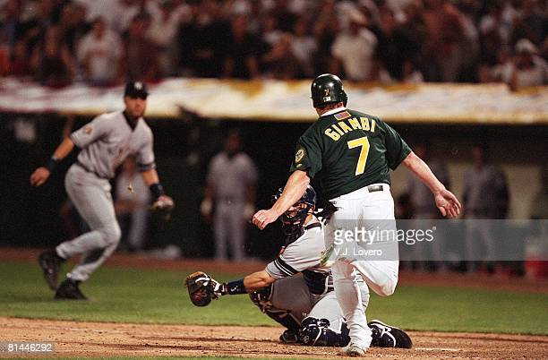Baseball AL playoffs Oakland Athletics Jeremy Giambi in action during tag out vs New York Yankees Jorge Posada Oakland CA